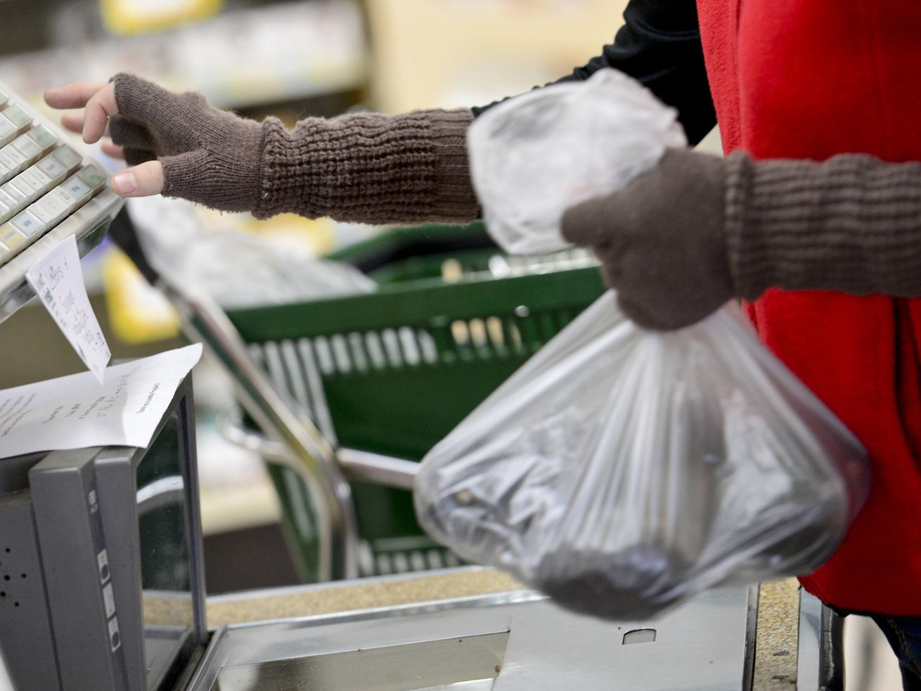 A supermarket cashier rings up groceries for a customer on December 6, 2013, in Boulder, Colorado.