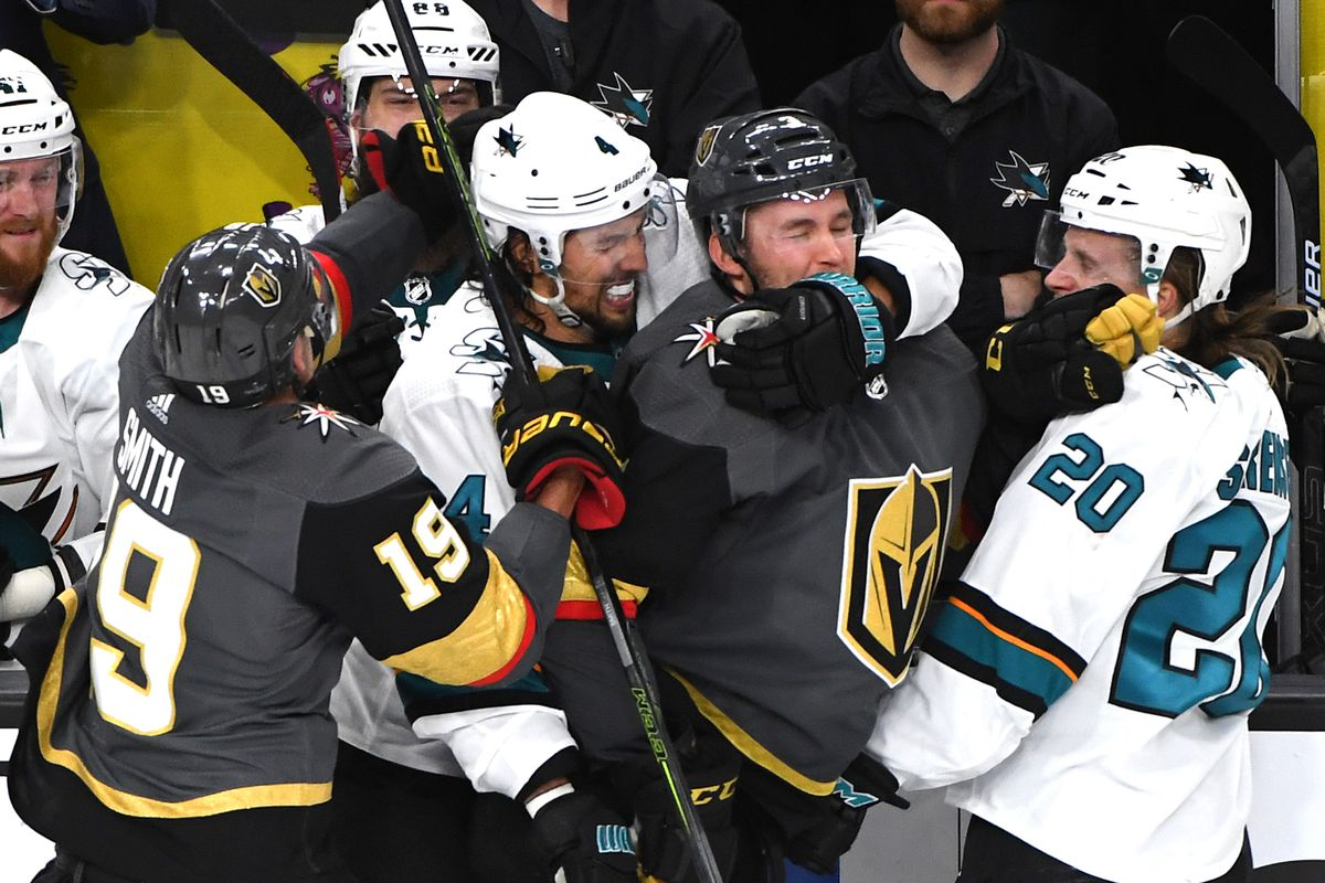 Vegas Golden Knights right wing Reilly Smith (19) looks to free Vegas Golden Knights defenseman Brayden McNabb (3) from the grip of San Jose Sharks defenseman Brenden Dillon (4) as he fights off San Jose Sharks left wing Marcus Sorensen (20) during the th