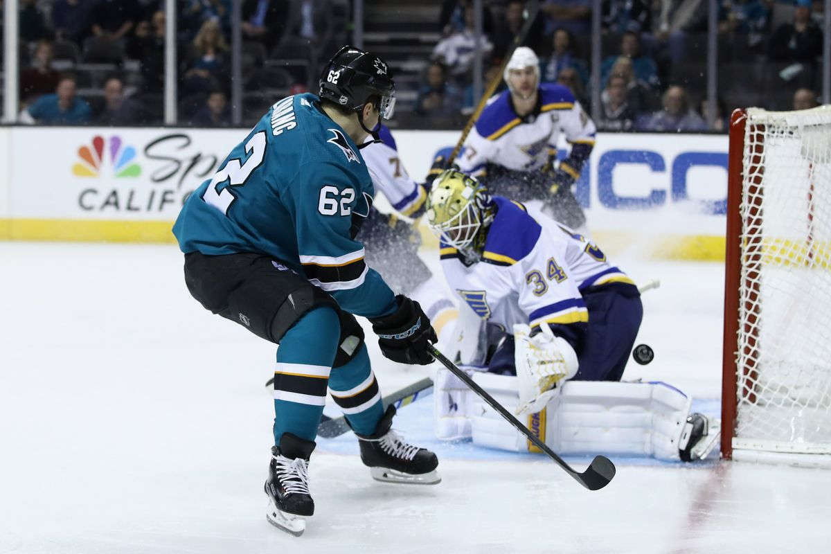 SAN JOSE, CA - MARCH 08: Kevin Labanc #62 of the San Jose Sharks tries to score unsuccessfully on Jake Allen #34 of the St. Louis Blues at SAP Center on March 8, 2018 in San Jose, California.