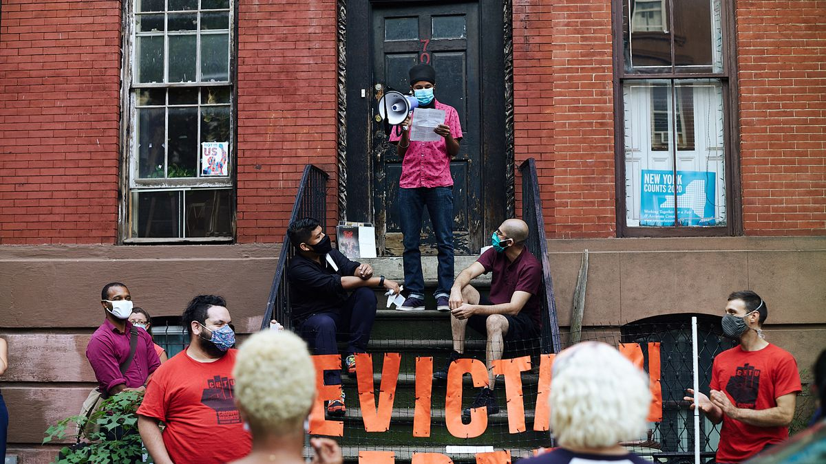 Resident Sonny Singh speaks as members of the Crown Heights Tenants Union hold a banner outside 70 South Elliott Place in Brooklyn, Sept. 11, 2020.