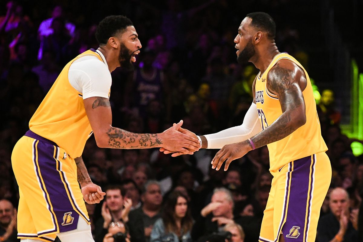 Los Angeles Lakers forward Anthony Davis and forward LeBron James celebrate during the third quarter against the Memphis Grizzlies at Staples Center.