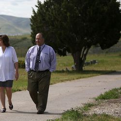 Traci Mariano, Jordan School District administrative assistant, and Scott Thomas, Jordan School District administrator, walk through the Bingham City Cemetery in Copperton on Thursday, May 25, 2017. The Jordan School Board has deeded the pioneer cemetery to Copperton Township after 44 years as owner and caretaker.