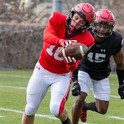 Utah receiver Britain Covey makes a catch during 2021 spring drills at the University of Utah in Salt Lake City.