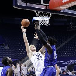 Caleb Lohner (33) of BYU fired a shot near the rim during the Cougars 86-61 victory over the New Orleans Privateers at Provo's Marriott Center on Thursday, November 26, 2020.
