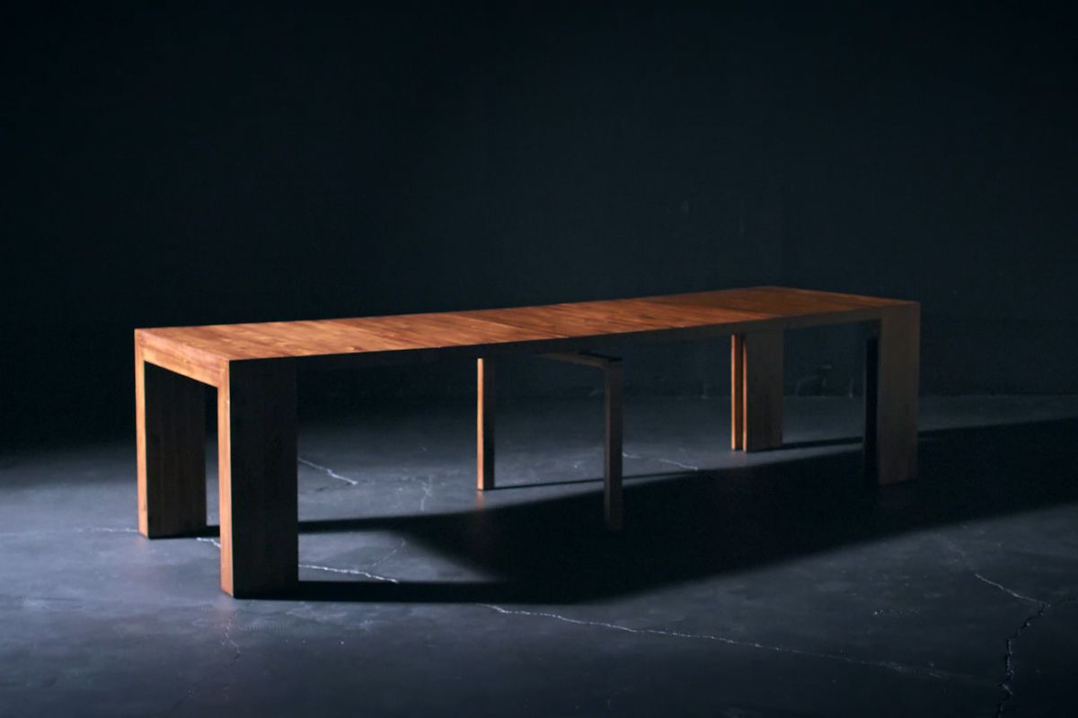 Long wooden table in a dark setting.