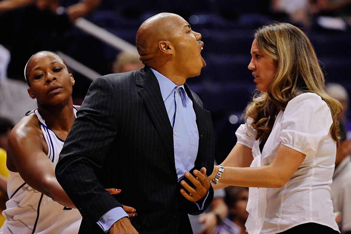 Mercury head coach Corey Gaines has to be restrained after being ejected for arguing a call with 14 seconds left in the game. The Storm handed the Mercury their first home loss of the season. June 21, 2009. Photo by Max Simbron