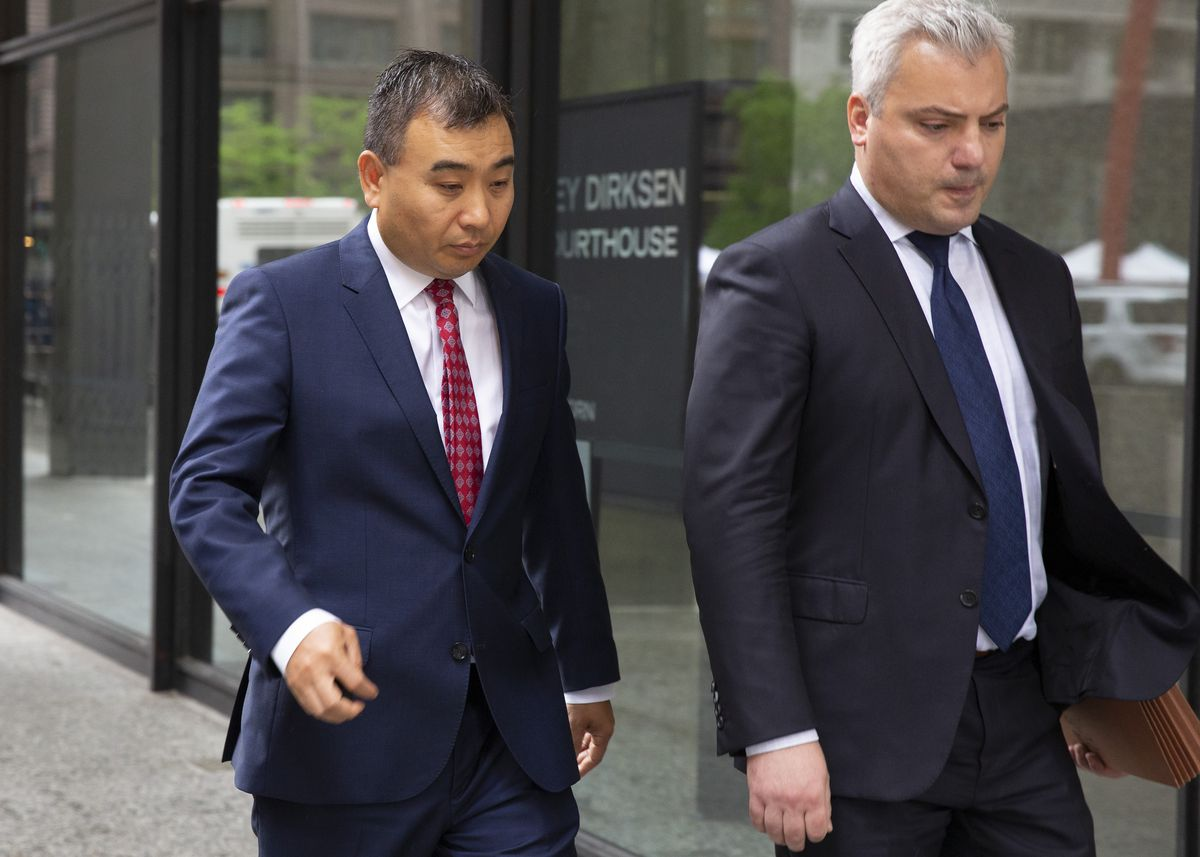 With his attorney Tinos Diamantatos (right), developer Charles Cui walks out of the Dirksen Federal Courthouse, Tuesday morning, June 4, 2019.