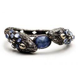"<strong>Alexis Bittar</strong> Jardin De Papillon Ruthenium & Gold Double Snake Sodalite Cabochon Encrusted Bracelet, <a href=""http://www.alexisbittar.com/jardin-gld-snake-sodalt-dia-br-bc32b019.html"">$395</a>"