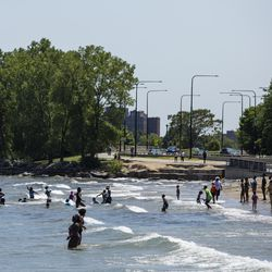 Kids, between the ages of 6 and 12, enrolled in the Chicago Park District summer camp at Nichols Park play in Lake Michigan at 57th Street Beach near Promontory Point on the South Side, Wednesday afternoon, July 24, 2019.