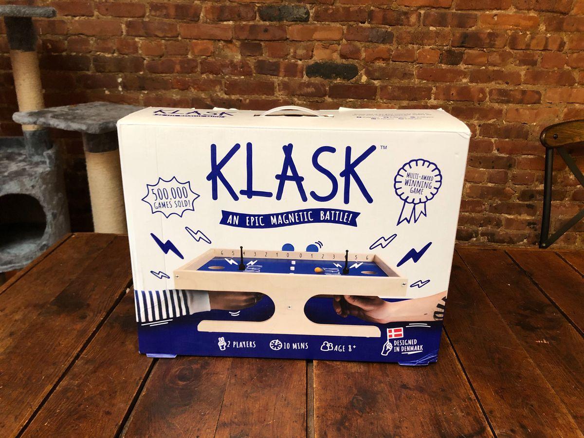 The Klask box on a kitchen table