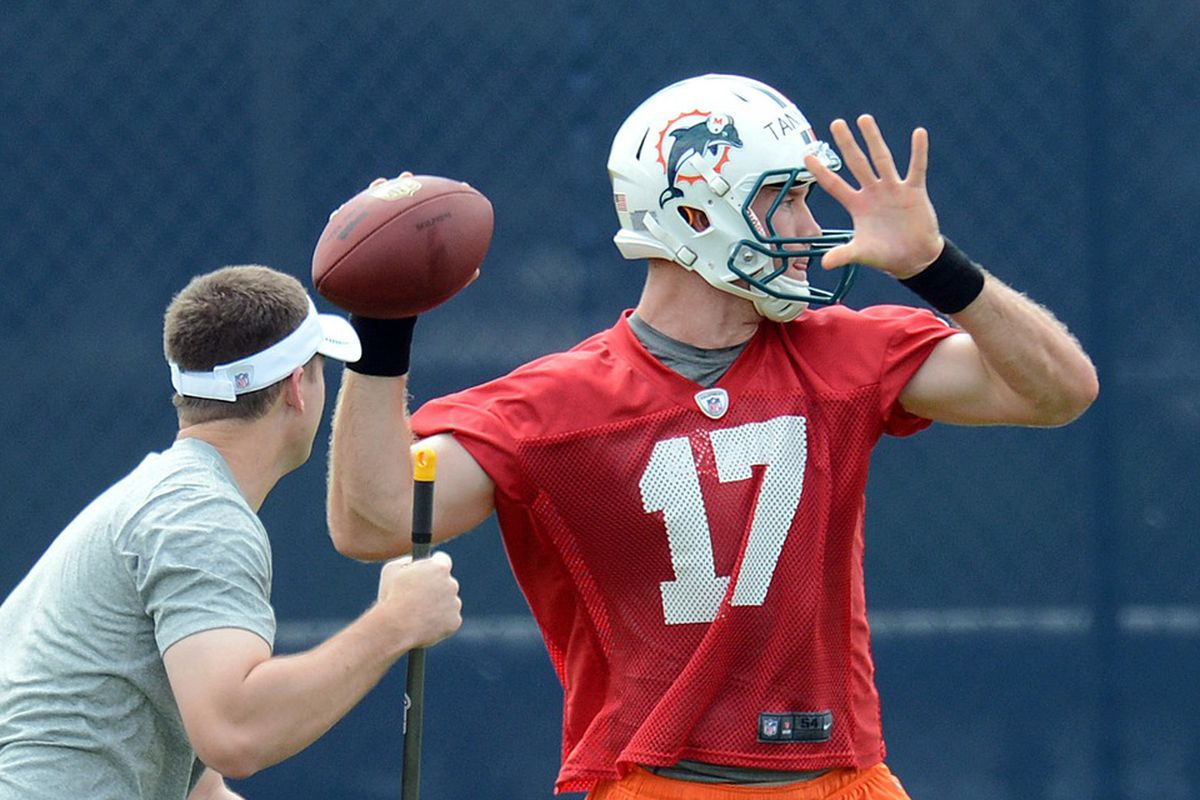 May 22, 2012; Davie, FL, USA; Miami Dolphins quarterback Ryan Tannehill (17) throws a pass during organized team activities at the Dolphins training facility. Mandatory Credit: Steve Mitchell-US PRESSWIRE
