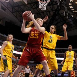 Iowa State forward Chelsea Poppens (33) looks for a shot opportunity against Baylor center Brittney Griner (42) as Makenzie Robertson (14) and Destiny Williams (10) watch in the second half of their NCAA college basketball championship game in the Big 12 Conference tournament, Monday, March 11, 2013, in Dallas.