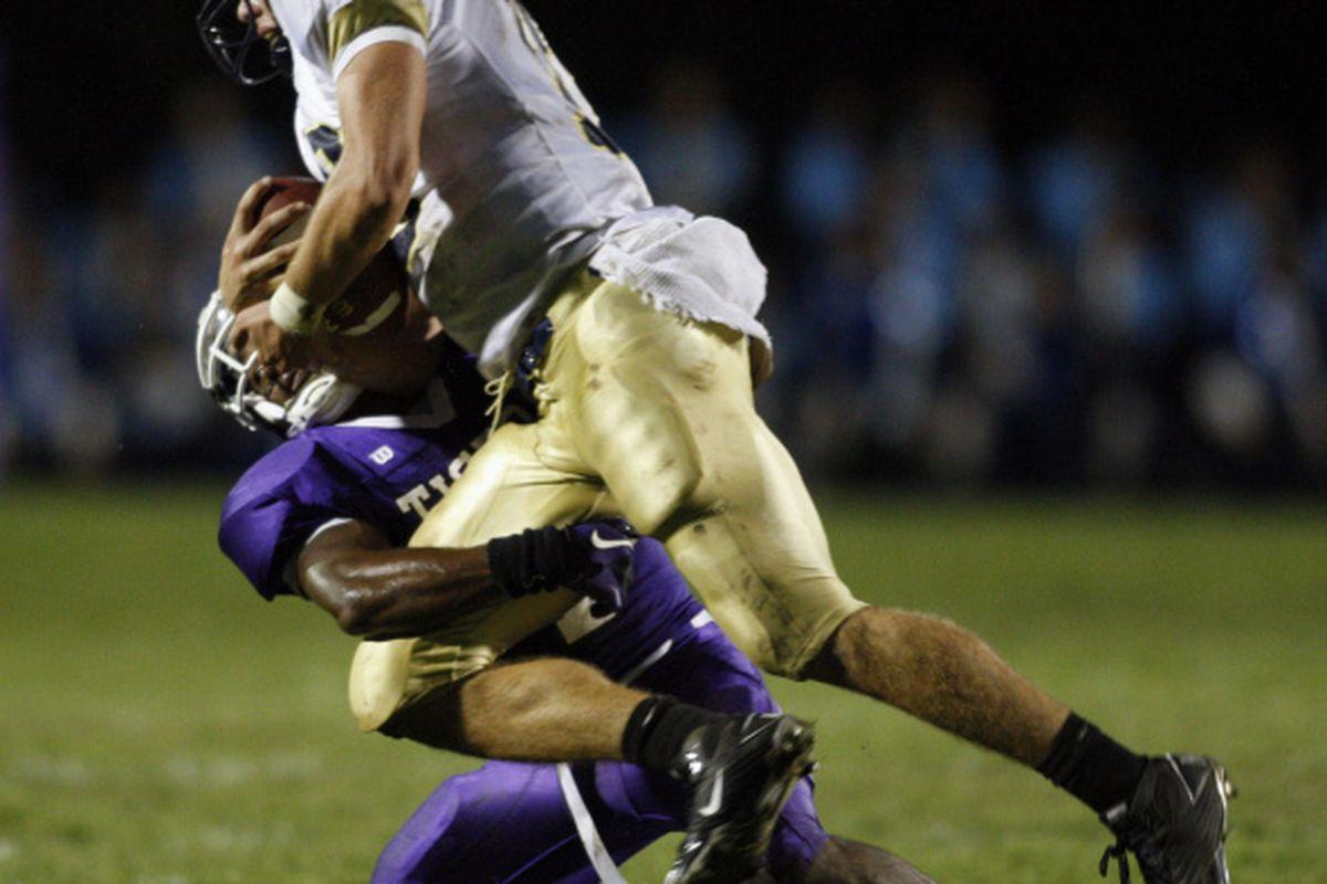 "via <a href=""http://www.10tv.com/live/content/sports/stories/2010/11/13/stingy-defense-tough-to-crack.html?sid=101"">www.10tv.com</a>Mike Brown drops Lancaster quarterback Nolan Flowers for a loss."