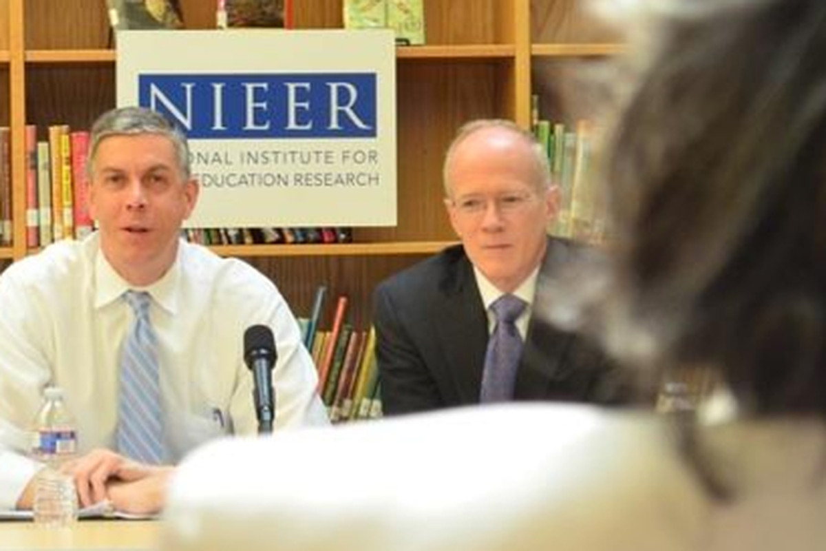 Secretary of Education Arne Duncan and National Institute for Early Education Research Co-Director Steven Barnett talk about early childhood education in Washington, D.C., in 2012. (Mikhail Zinshteyn/Education Writers Association)
