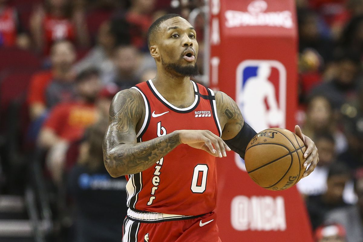 Portland Trail Blazers guard Damian Lillard dribbles the ball during the first quarter against the Houston Rockets at Toyota Center.