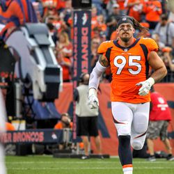 Broncos DE Derek Wolfe is announced and runs onto the field.