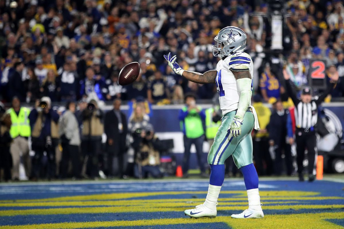 Dallas Cowboys running back Ezekiel Elliott celebrates after scoring a 1 yard touchdown in the third quarter against the Los Angeles Rams in the NFC Divisional Playoff game at Los Angeles Memorial Coliseum on January 12, 2019 in Los Angeles, California.