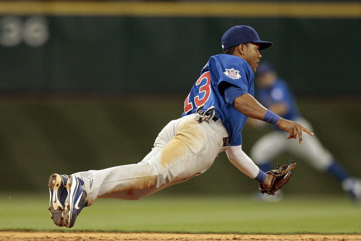 Shortstop Starlin Castro of the Chicago Cubs makes a diving catch on a line drive against the Houston Astros at Minute Maid Park on April 12, 2011 in Houston, Texas.  (Photo by Bob Levey/Getty Images)