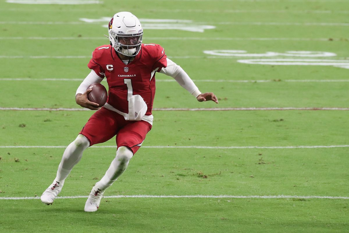 Quarterback Kyler Murray #1 of the Arizona Cardinals carries the football en route to scoring a 14-yard rushing touchdown against the Washington Football Team during the first half of the NFL game at State Farm Stadium on September 20, 2020 in Glendale, Arizona. The Cardinals defeated the Washington Football Team 30-15.