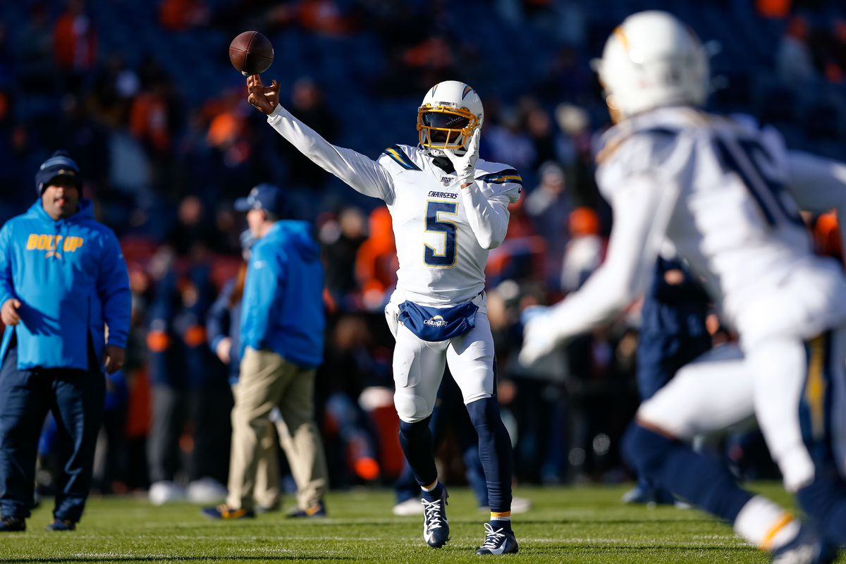 Los Angeles Chargers quarterback Tyrod Taylor warms up before the game against the Denver Broncos at Empower Field at Mile High.