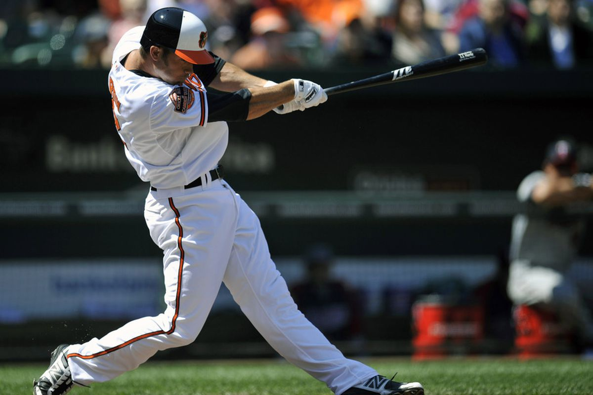 April 8, 2012; Baltimore, MD, USA; Baltimore Orioles shortstop J.J. Hardy (2) hits a solo home run in the first inning against the Minnesota Twins at Oriole Park at Camden Yards. Mandatory Credit: Joy R. Absalon-US PRESSWIRE