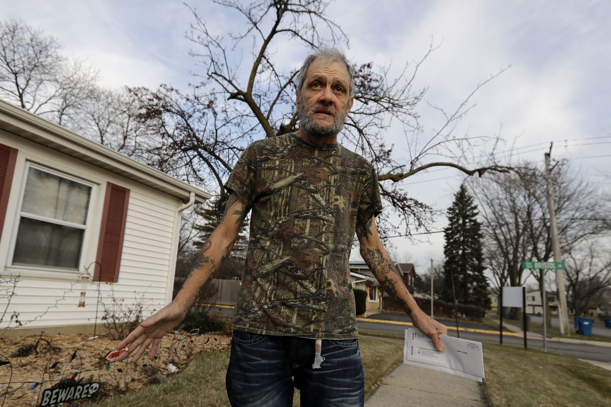 Bobby Goldberg in front of his suburban Chicago home.