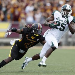 Michigan State receiver Keith Mumphrey (25) runs with the ball as he is pursued by Central Michigan safety Jahleel Addae (4) during the first quarter of an NCAA college football game on Saturday, Sept. 8, 2012, in Mount Pleasant, Mich.