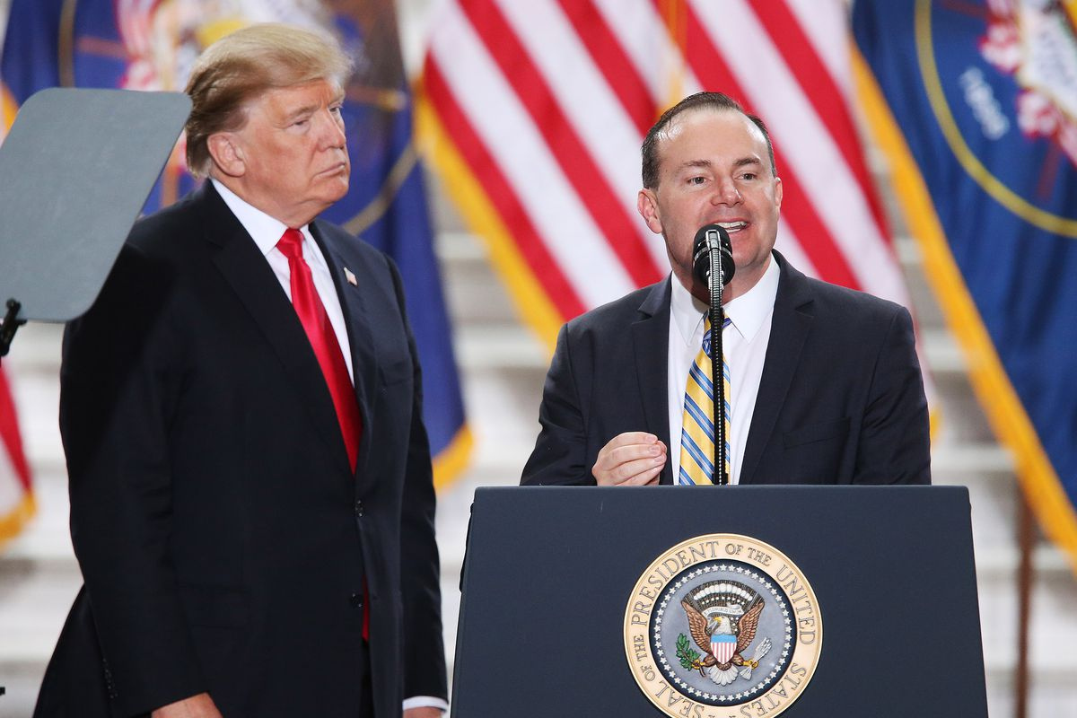 Sen. Mike Lee, R-Utah, speaks as President Donald Trump looks on at the Capitol in Salt Lake City on Monday, Dec. 4, 2017. Trump was in town to sign proclamations scaling back Bears Ears and Grand Staircase-Escalante national monuments.