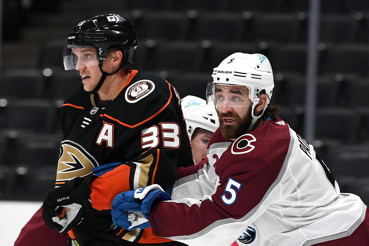 Colorado Avalanche Defenseman Greg Pateryn (5) stays in front of Anaheim Ducks Right Wing Jakob Silfverberg (33) near the Avalanche goal in the second period of a game played on January 22, 2021 at the Honda Center in Anaheim, CA.