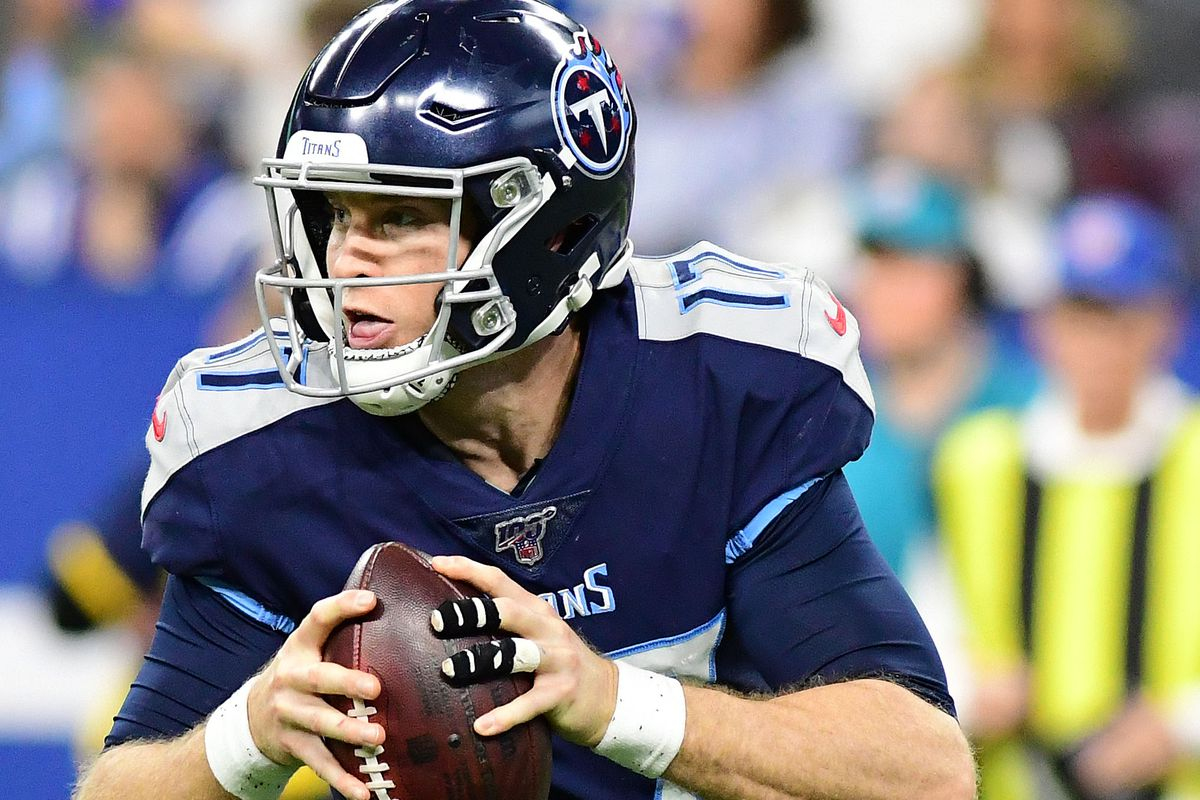 Tennessee Titans quarterback Ryan Tannehill rolls out of the pocket in the second half against the Indianapolis Colts at Lucas Oil Stadium