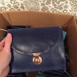 Bargain box navy bag, $40, originally $225