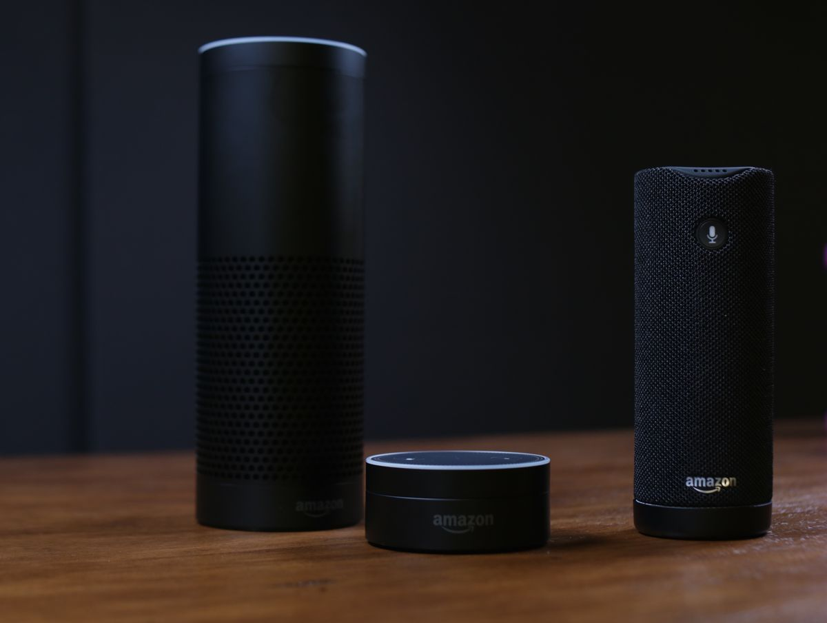 The Echo Dot (m) and Amazon Tap (r) join the Echo in Amazon's voice-controlled device family.