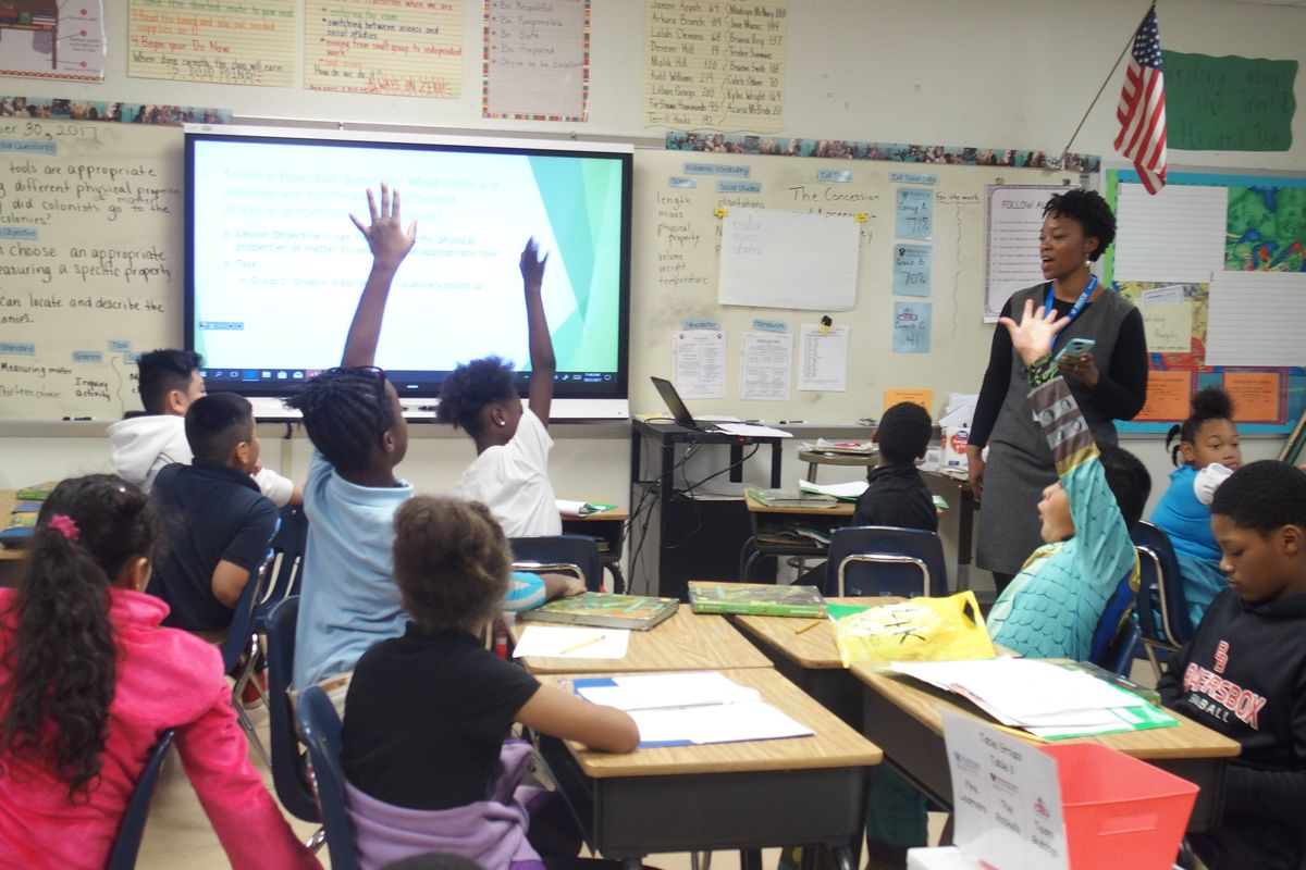 Michelle Edwards instructs fourth-graders at Bruce Elementary School, which has a hundred more students this year. The  classroom was one of seven empty ones last year at the Memphis school, compared to just one this year.