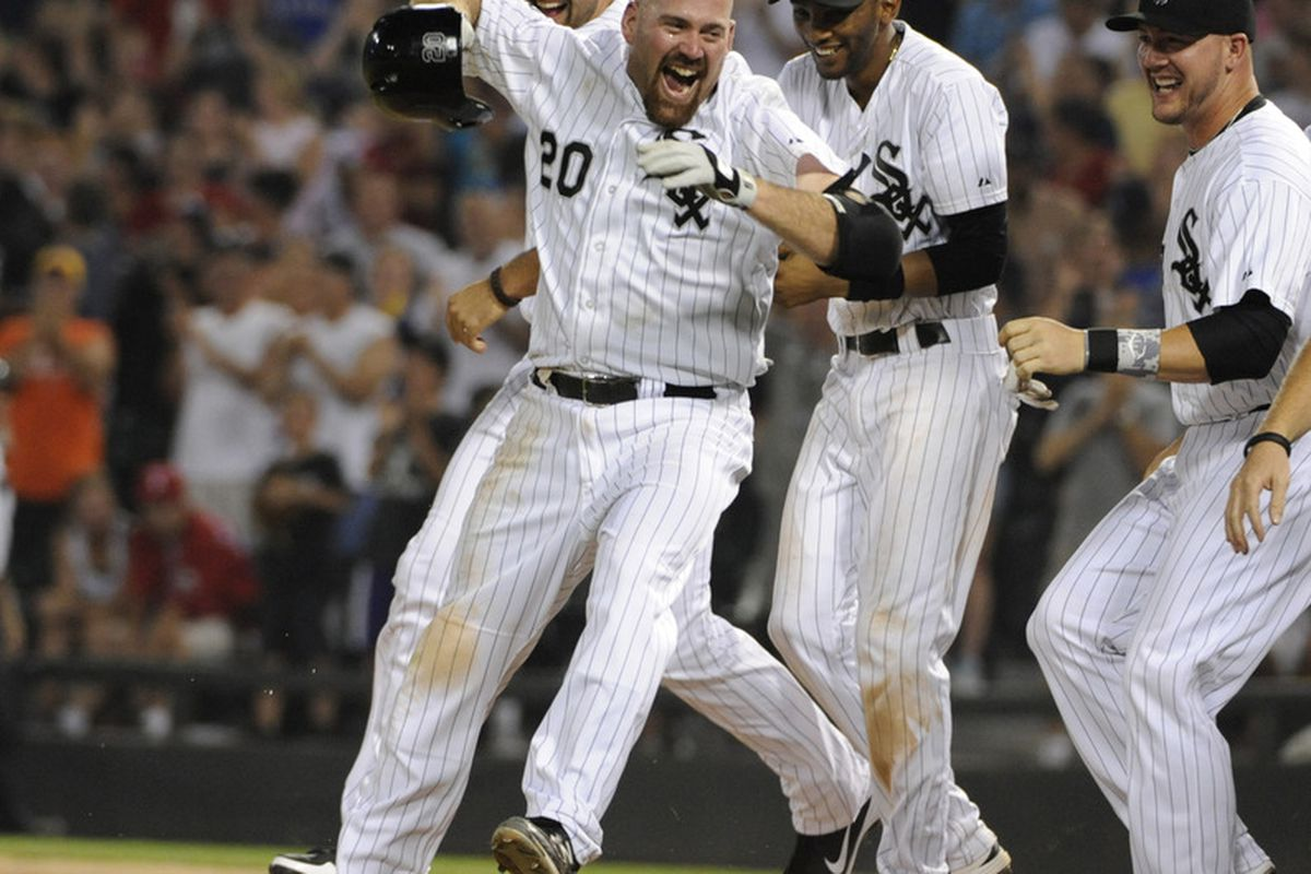Kevin Youkilis has already smiled more in Chicago than he did in Boston.