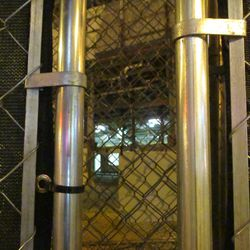 5:56 p.m. View through a gap in the fence, that is front of the ballpark -