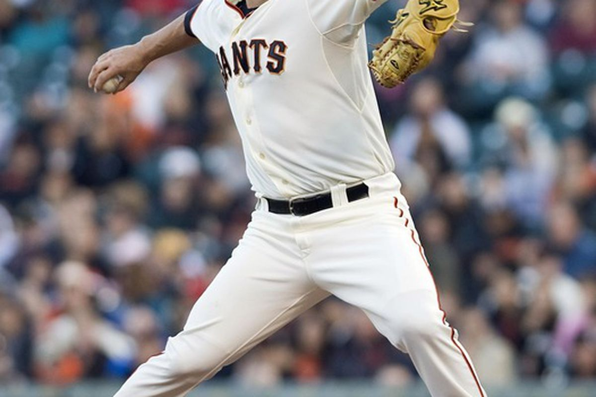 June 13, 2012; San Francisco, CA, USA; San Francisco Giants starting pitcher Matt Cain (18) pitches during the first inning against the Houston Astros at AT&T Park.  Mandatory Credit: Ed Szczepanski-US PRESSWIRE