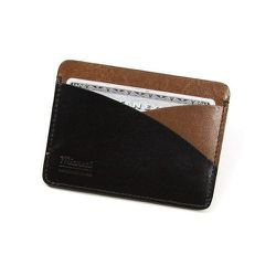 "<strong>Miansai</strong> Cardholder in Oil/Black, <a href=""http://www.miansai.com/shop/wallets/cardholder-87d5b7"">$95</a>"