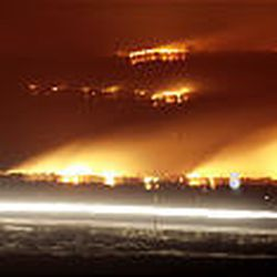 A time-exposure photo shows flames and smoke near Fillmore from the huge blaze. The fire resulted in close calls for several truckers on I-15, some of whom left their trailers behind to escape the flames.
