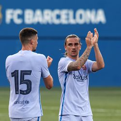 Griezmann and Lenglet at the end of the match