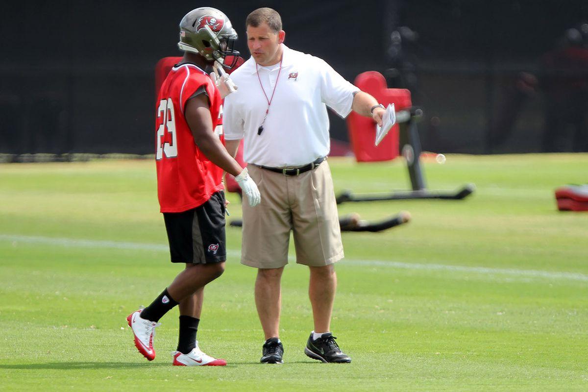 May 4, 2012; Tampa, FL, USA; Tampa Bay Buccaneers head coach Greg Schiano talks with cornerback Leonard Jackson (29) during rookie mini camp at One Buc.   Mandatory Credit: Kim Klement-US PRESSWIRE