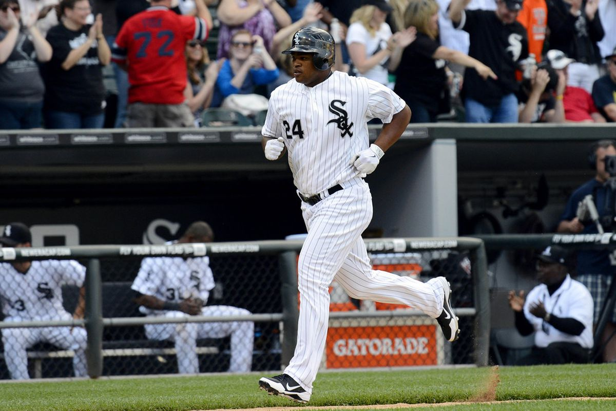 Jun 02, 2012; Chicago, IL, USA; Chicago White Sox left fielder Dayan Viciedo (24) hits a home run against the Seattle Mariners during the eighth inning at US Cellular Field.  Mandatory Credit: Mike DiNovo-US PRESSWIRE