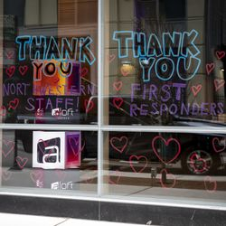 Thank you messages for Northwestern Memorial Hospital staff and first responders in the windows of Aloft Chicago Mag Mile, 243 E. Ontario St., during the coronavirus pandemic, Monday afternoon, April 6, 2020.