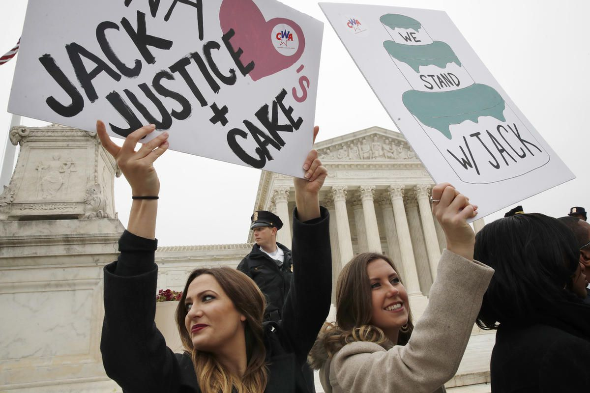 Janae Stracke, left, and Annabelle Rutledge, both with Concerned Women for America, hold up signs in support of cake artist Jack Phillips outside of the Supreme Court which is hearing the 'Masterpiece Cakeshop v. Colorado Civil Rights Commission,' Tuesday