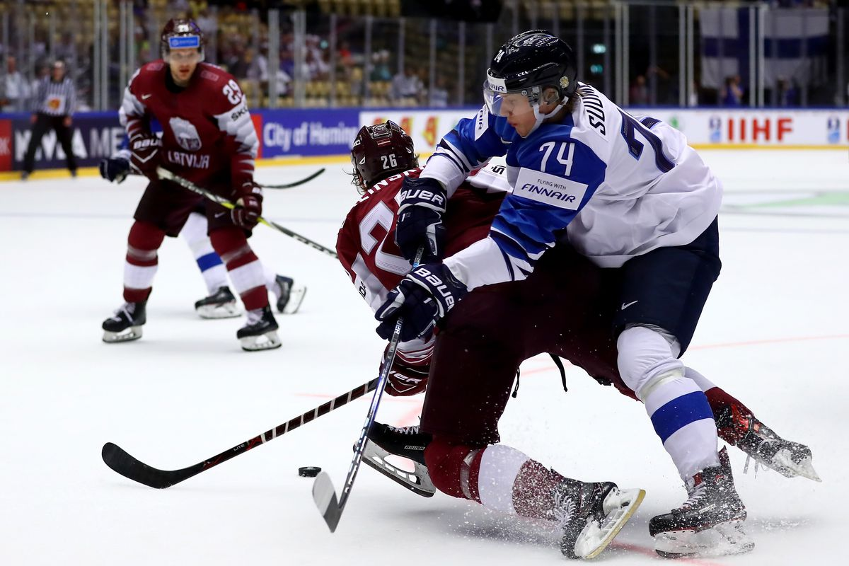 HERNING, DENMARK - MAY 06: Uvis Balinskis (L) of Latvia and Antti Suomela of Finland battle for the puck during the 2018 IIHF Ice Hockey World Championship group stage game between Latvia and Finland at Jyske Bank Boxen on May 6, 2018 in Herning, Denmark.