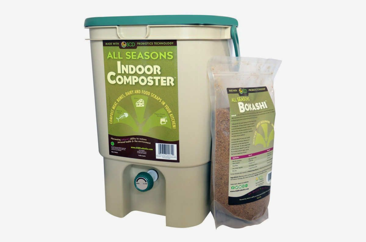 Beige colored bin with green lid.
