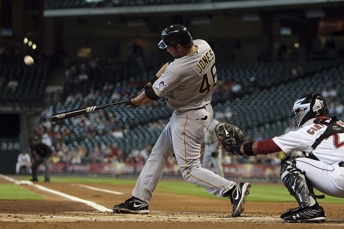 HOUSTON - JUNE 16:  Garrett Jones #46 of the Pittsburgh Pirates hits a three run home run in the first inning against the Houston Astros at Minute Maid Park on June 16, 2011 in Houston, Texas.  (Photo by Bob Levey/Getty Images)