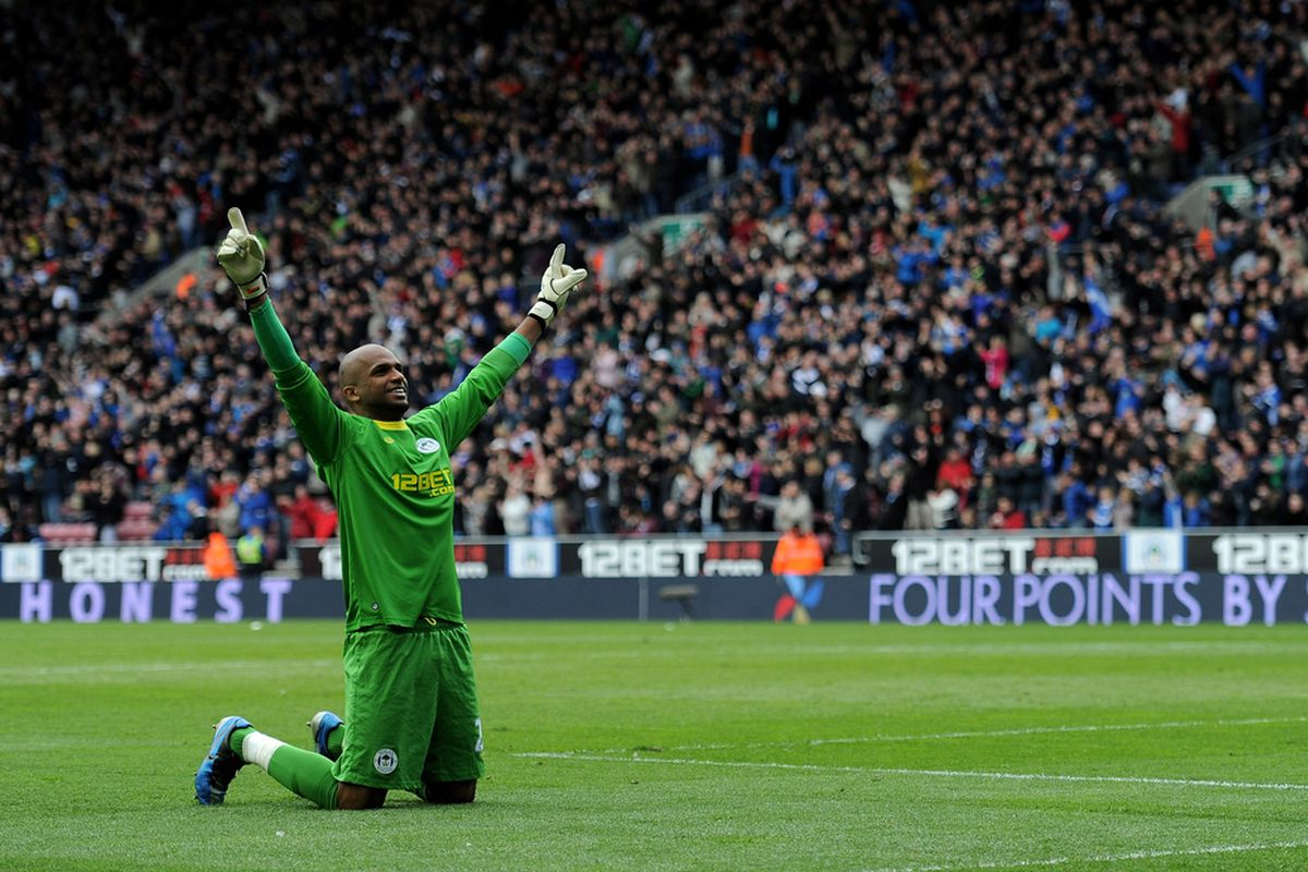 Ali Al Habsi of Wigan Athletic celebrates his team's third goal during the Barclays Premier League match between Wigan Athletic and Newcastle United at the DW Stadium.