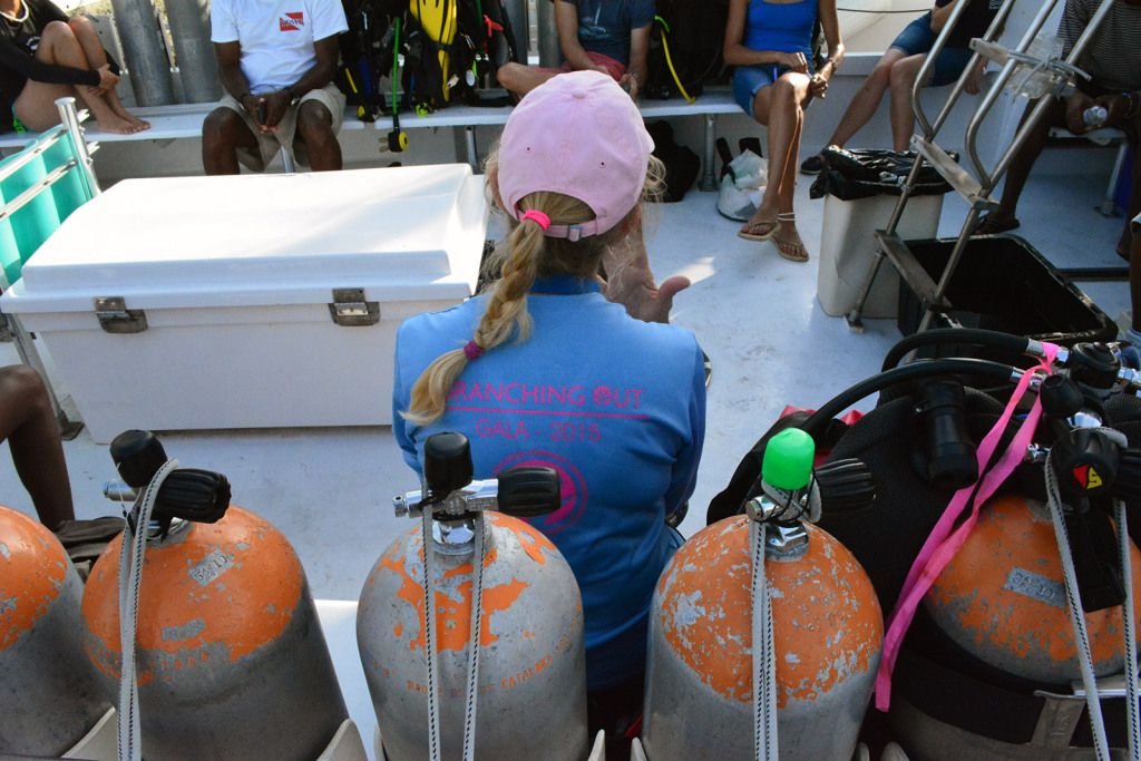 A volunteer coordinator for CRF readies a boatload of divers.