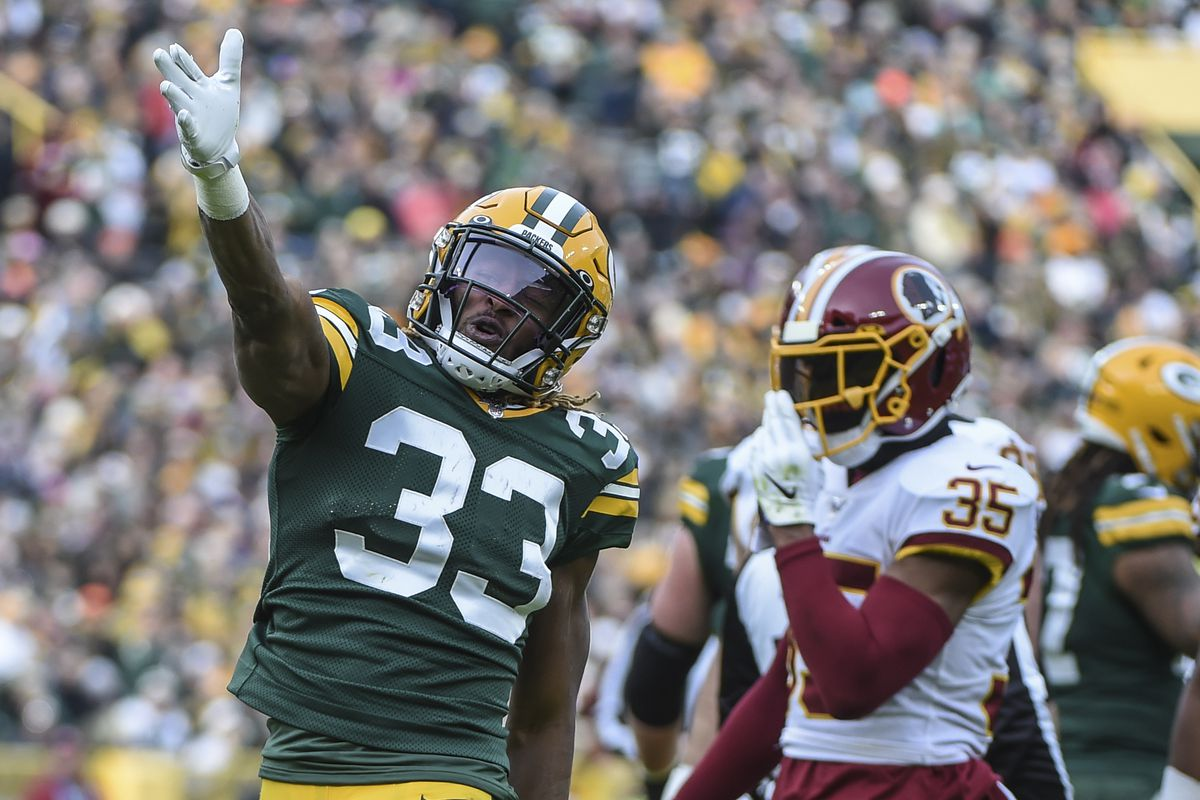 Green Bay Packers running back Aaron Jones reacts after picking up a first down in the first quarter during the game against the Washington Redskins at Lambeau Field