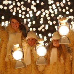 Children with lanterns are pictured during the Salt Lake 2002 Winter Games opening ceremony at the University of Utah's Rice-Eccles Stadium in Salt Lake City on Friday, Feb 8, 2002.